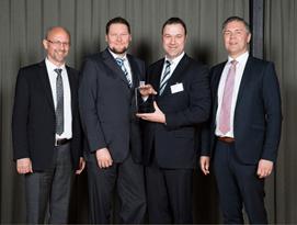 Magna Receiving Award
