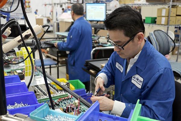 Mircom Staff working on Electronics