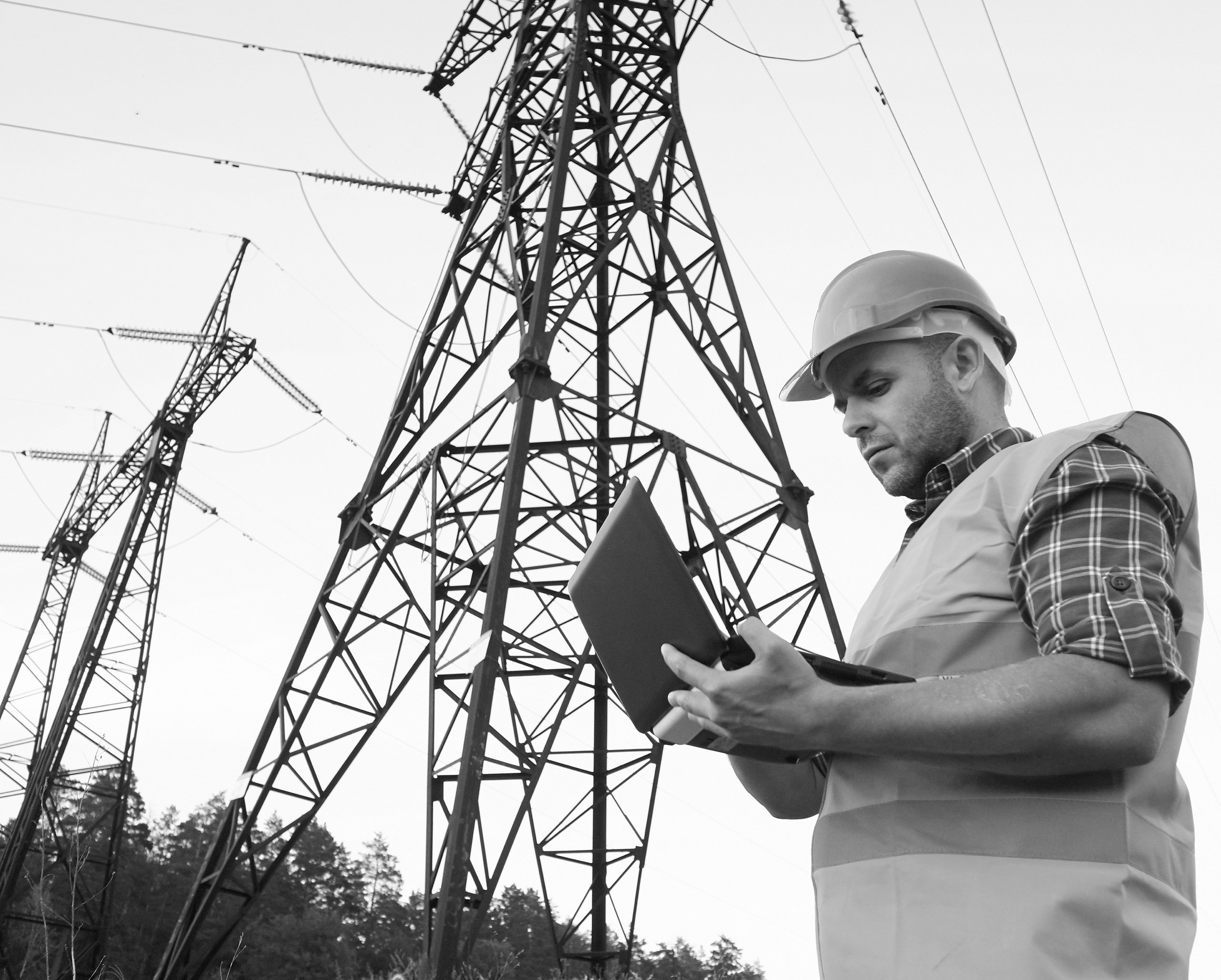 Man in front of electrical tower