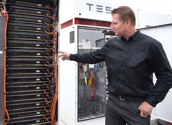 Man points at tesla battery storage Photo Credit: Susie Kockerscheidt / Torstar