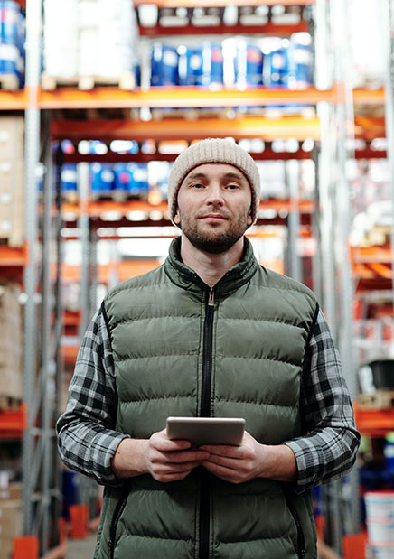 Man in Logistics Warehouse