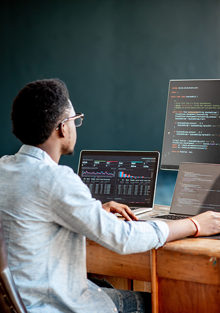 Student on Computer Writing Code