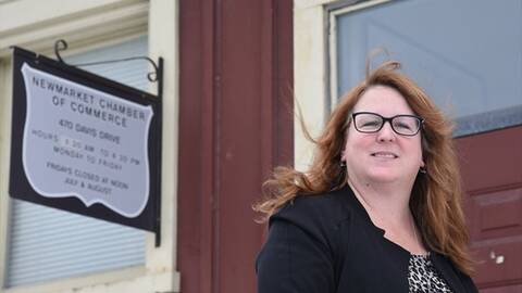 Tracy Walters of the Newmarket chamber of commerce stands in front of her office