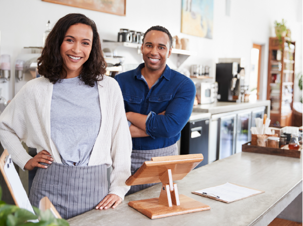image of two small business owners standing behind a counter