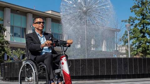 Man in Companion Wheelchair